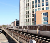 manage unwanted sound | image of train on tracks going through the city
